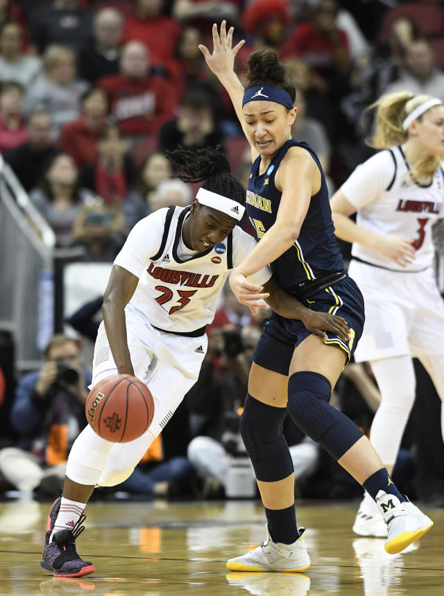 Louisville guard Jazmine Jones (23) tries to get past the defense of Michigan forward Hailey Brown (15) during the first half of a second-round game in the NCAA women's college basketball tournament in Louisville, Ky., Sunday, March 24, 2019. (AP Photo/Timothy D. Easley)