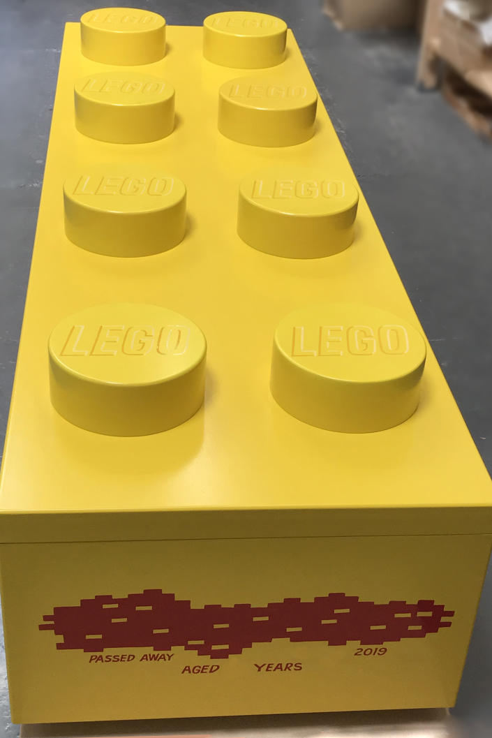 A coffin in the shape of a Lego brick. (Photo: Caters News)