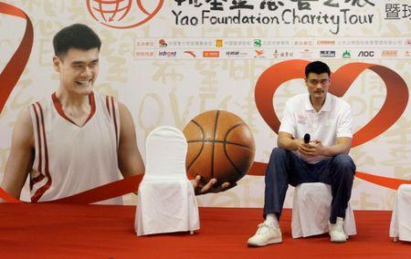 Houston Rockets center Yao Ming listens to a question at a news conference for Yao Foundation Charity Tour, in Beijing July 22, 2010. REUTERS/Jason Lee