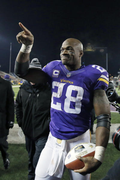 FILE - In this Dec. 27, 2015, file photo, Minnesota Vikings running back Adrian Peterson (28) points to fans as he leaves the field after the Vikings defeated the New York Giants 49-17 in an NFL football game in Minneapolis. Peterson was selected to the 2010s NFL All-Decade Team announced Monday, April 6, 2020, by the NFL and the Pro Football Hall of Fame. (AP Photo/Ann Heisenfelt, File)