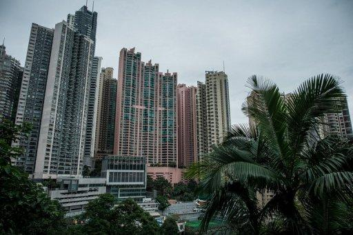 Residential buildings with parking spaces at their base are seen in Hong Kong