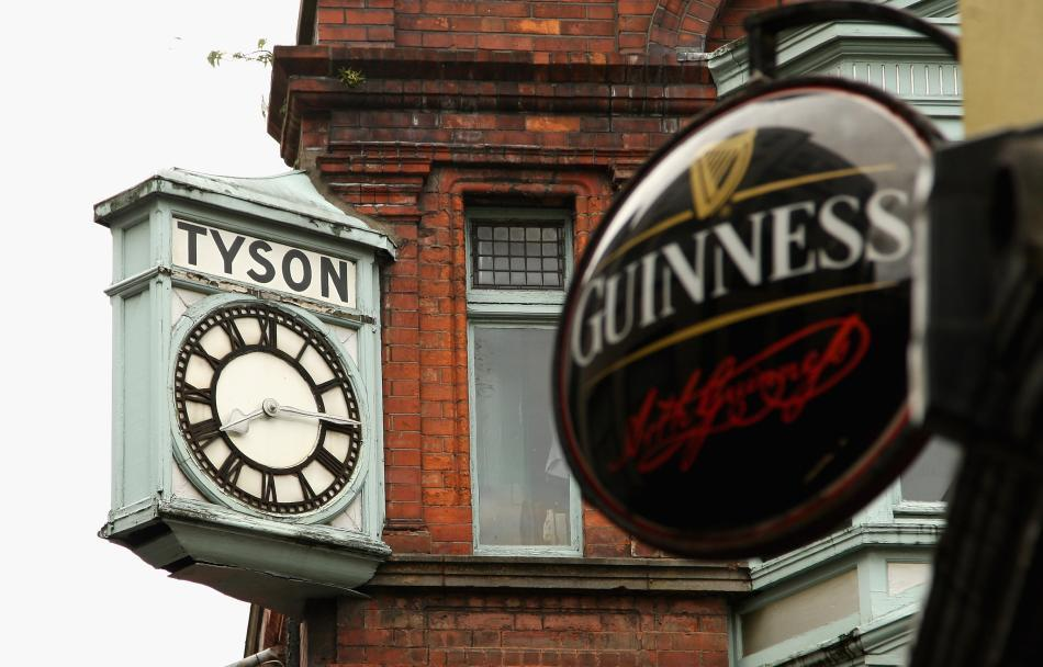 A clock is seen above a pub in Dublin. Guinness is Ireland's most recognisable brand of beer.