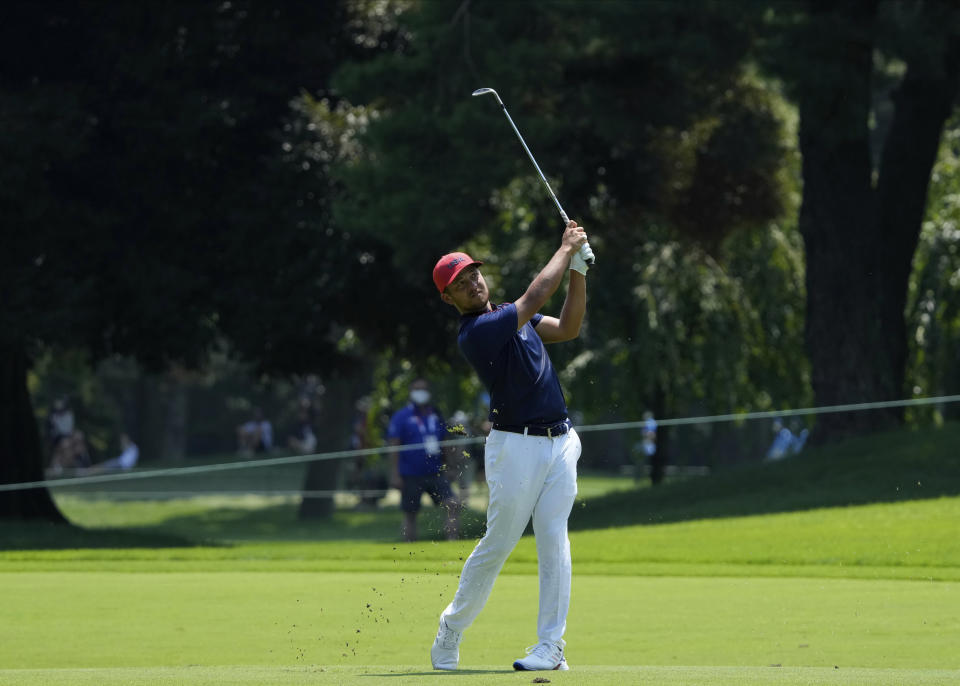 CORRECTS LAST NAME TO SCHAUFFELE FROM SHAUFFELE - Xander Schauffele of the United States watches his shot from the 7th fairway during the final round of the men's golf event at the 2020 Summer Olympics on Sunday, Aug. 1, 2021, in Kawagoe, Japan. (AP Photo/Andy Wong)