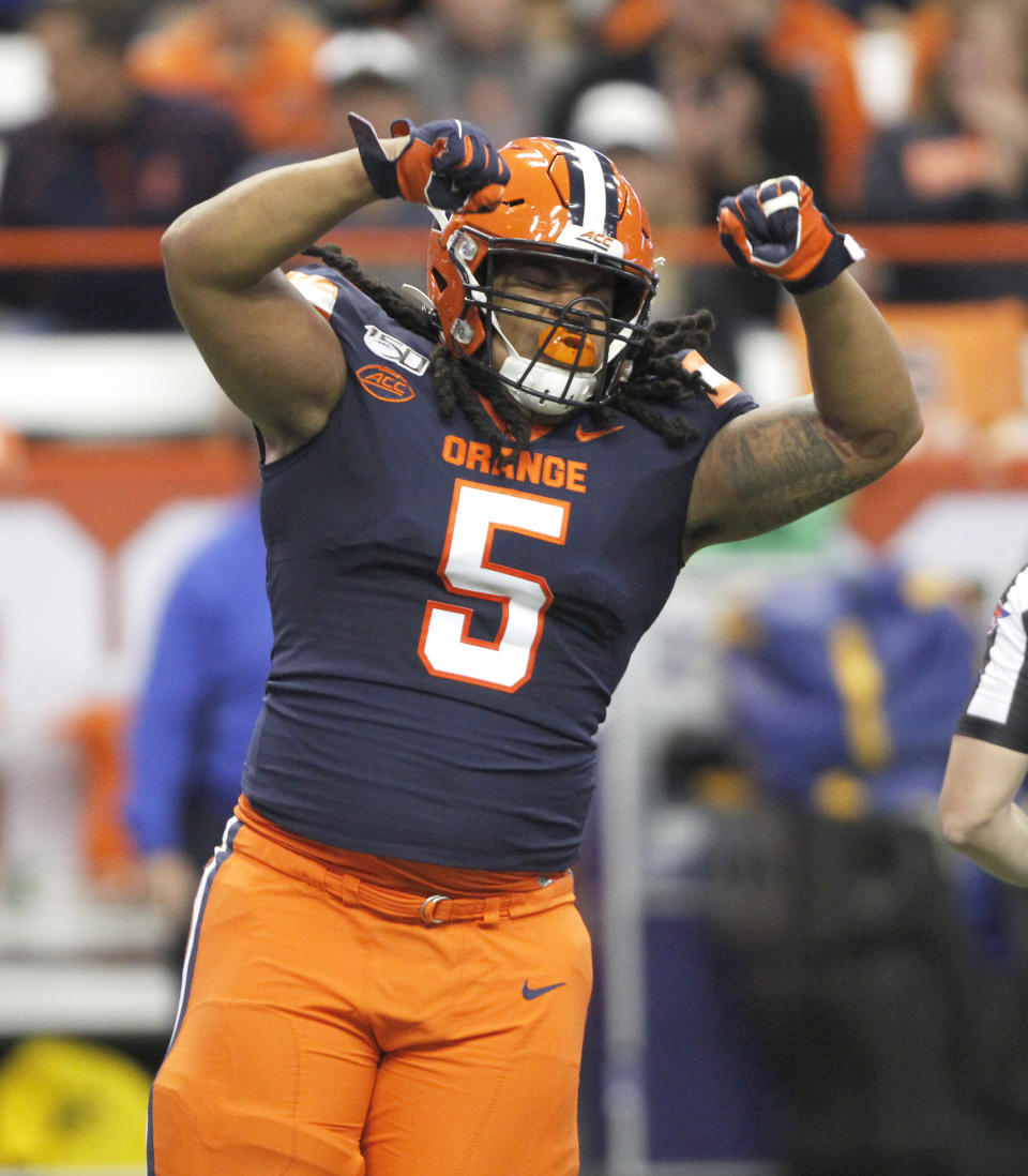 Syracuse's Chris Elmore celebrates after making a tackle during the first quarter of the team's NCAA college football game against Pittsburgh in Syracuse, N.Y., Friday, Oct. 18, 2019. (AP Photo/Nick Lisi)