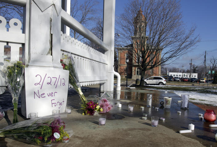 Flowers and candles sit next to the gazebo on the square in Chardon, Ohio Tuesday, Feb. 28, 2012 as a tribute to victims of a school shooting Monday after gunman opened fire inside the high school's cafeteria at the start of the school day. Two of the victims have died and three remain hospitalized (AP Photo/Mark Duncan)