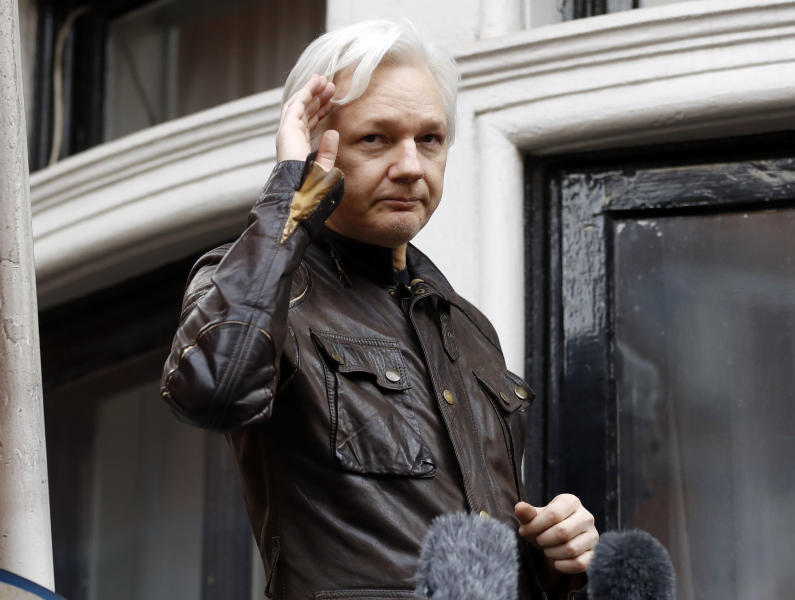 FILE - In this May 19, 2017 file photo, WikiLeaks founder Julian Assange greets supporters from a balcony of the Ecuadorian embassy in London. Ecuador's President Lenin Moreno said in a radio interview Thursday, Dec. 6, 2018, Britain has provided sufficient guarantees for Assange to leave his government's embassy in London, where the WikiLeaks founder has been living under asylum since 2012. (AP Photo/Frank Augstein, File)