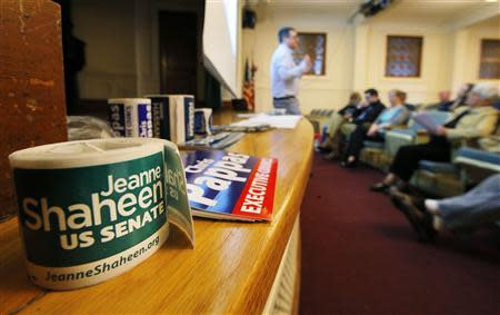 Campaign stickers for U.S. Senator Jeanne Shaheen (D-NH) are on hand at a Manchester Democratic Summit in Manchester, New Hampshire May 10, 2014. REUTERS/Brian Snyder