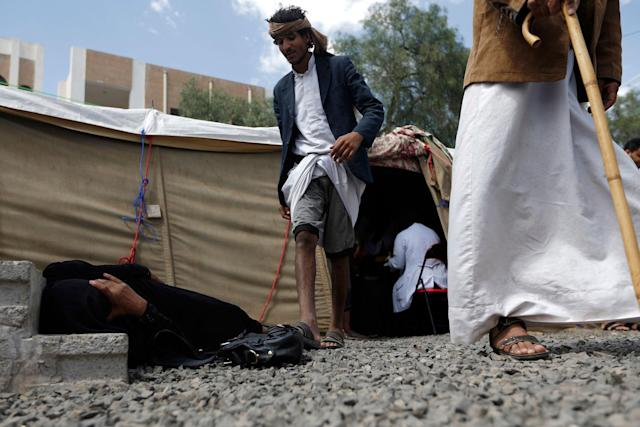 <p>A Yemeni woman suspected of being infected with cholera lies on the ground at Sabaeen Hospital in Sana'a on June 13, 2017.<br> Six weeks into the second outbreak of the deadly disease in less than a year, at least one patient checks in at Sabaeen every 60 seconds — a level of emergency that overwhelms staff. (Mohammed Huwais/AFP/Getty Images) </p>