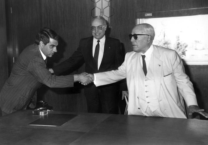 In this file photo taken on New Year's day 1986, former Tunisian President Habib Ben Ali Bourguiba (R) shakes hands with his then prime minister Zine El-Abidine Ben Ali, who went on to replace him the following year (AFP Photo/-)
