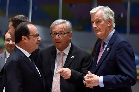 European Chief Negotiator for Brexit Michel Barnier chats with European Commission President Jean-Claude Juncker and France's President Francois Hollande during a EU summit in Brussels, Belgium April 29, 2017. Reuters/Eric Vidal