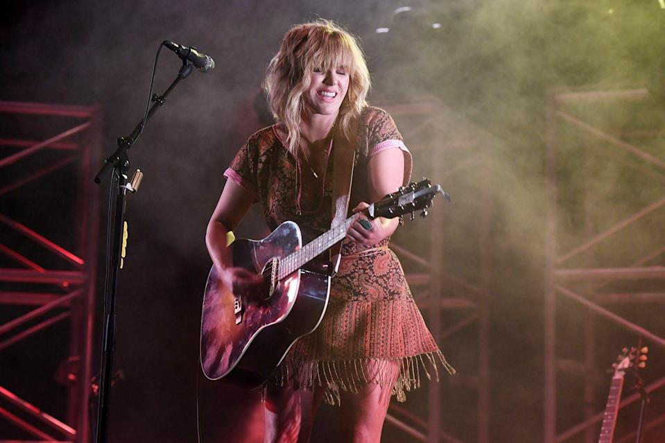 <p>Grace Potter gets down during a performance at the Old School Square Pavilion in Delray Beach, Florida, on Saturday.</p>