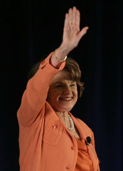 U.S. Sen. Dianne Feinstein waves to a cheering audience before speaking to the Commonwealth Club in San Francisco, Wednesday, April 3, 2013. Feinstein spoke to the group about guns and drones. She says the U.S. should restrain the use of guns on the street and drones in the air. (AP Photo/Eric Risberg)
