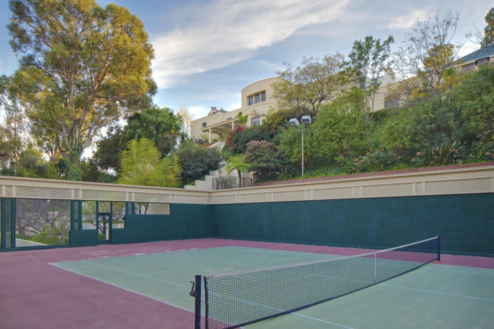 <p>The grounds include this fully lighted, sunken, regulation tennis court.</p>
