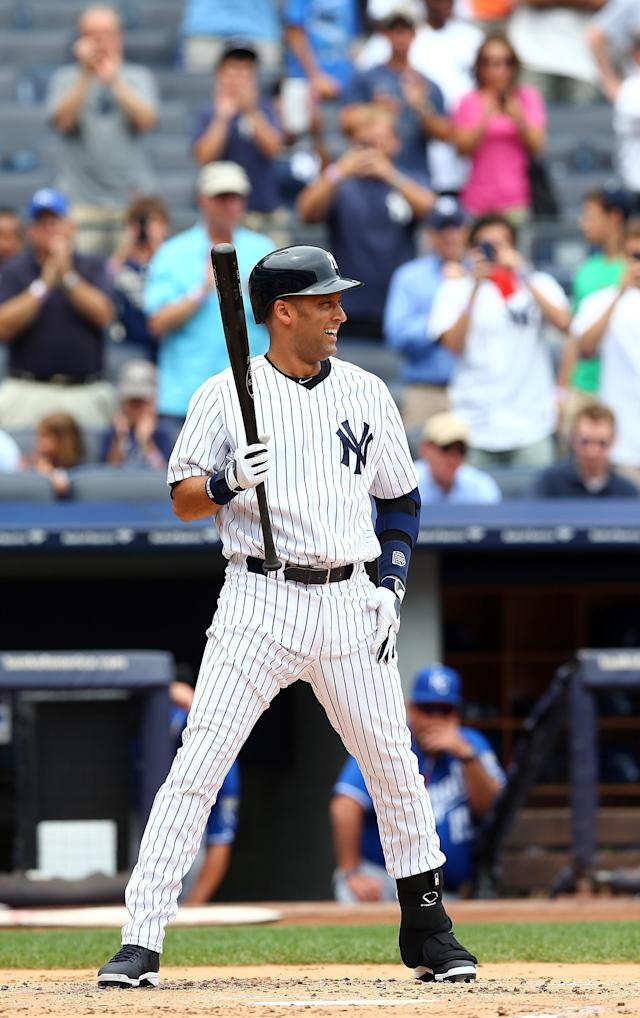 NEW YORK, NY - JULY 11: Derek Jeter #2 of the New York Yankees is cheered as he takes his first at bat of the game in the first inning against the Kansas City Royals on July11,2013 at Yankee Stadium in the Bronx borough of New York City. (Photo by Elsa/Getty Images)