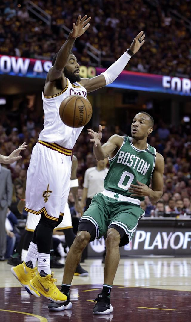 <p>Boston Celtics' Avery Bradley (0) passes around Cleveland Cavaliers' Kyrie Irving (2) during the first half of Game 3 of the NBA basketball Eastern Conference finals, Sunday, May 21, 2017, in Cleveland. (AP Photo/Tony Dejak) </p>
