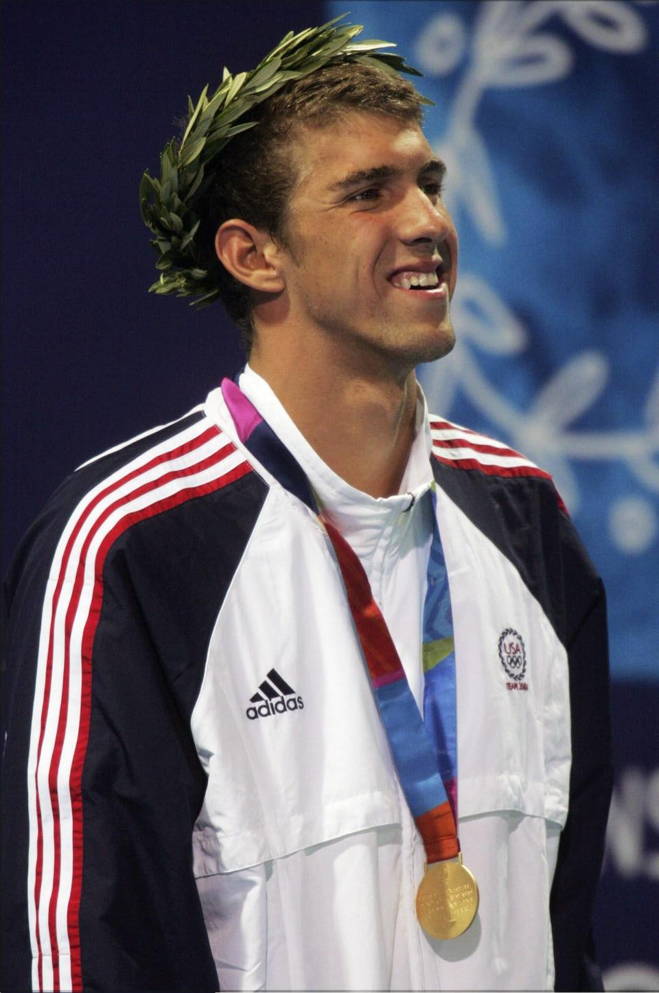 <b>Medal No. 6</b><br>Michael Phelps set an Olympic record with a time of 1:57.14 to win gold in the 200m IM in Athens.