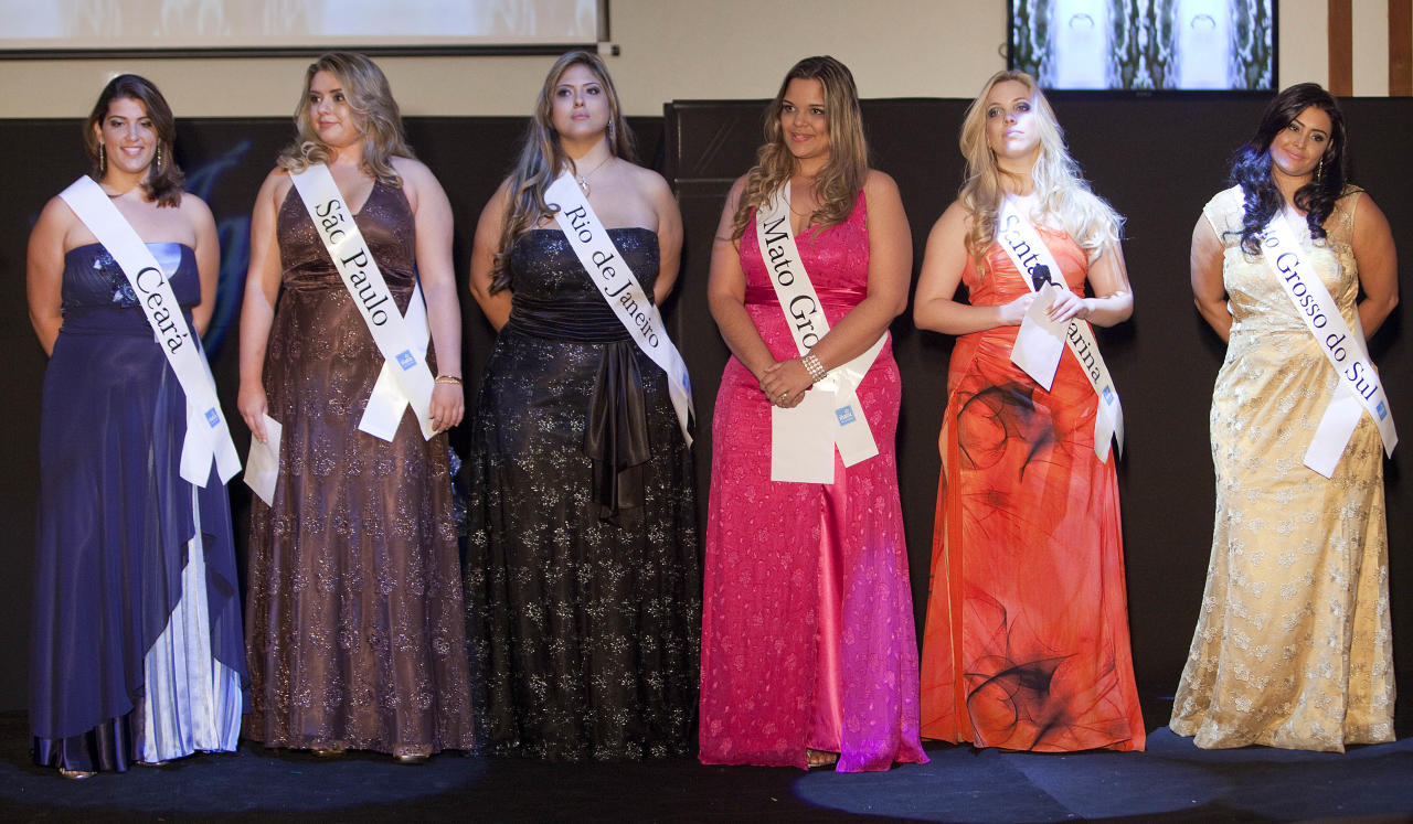 Contestants, from left: Larissa Rodrigues, from Ceara state, Sylvia Barreto, from Sao Paulo state, Roberta Breves, from Rio de Janeiro state, Mirna Tardim, from Mato Grosso state, Laila Gori, from Santa Catarina state and Barbara Monteiro, from Mato Grosso do Sul state, stand on the stage during the Miss Brazil Plus Size Beauty Pageant in Sao Paulo, Brazil, Sunday, Jan. 29, 2012. (AP Photo/Andre Penner)