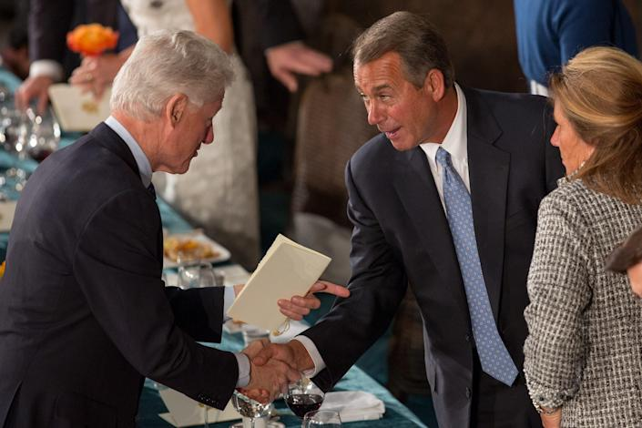 Former President Bill Clinton shakes hands with House Speaker John Boehner at the Inaugural Luncheon in Statuary Hall on Inauguration day at the U.S. Capitol building January 21, 2013 in Washington D.C.  U.S. President Barack Obama was ceremonially sworn in for his second term today.