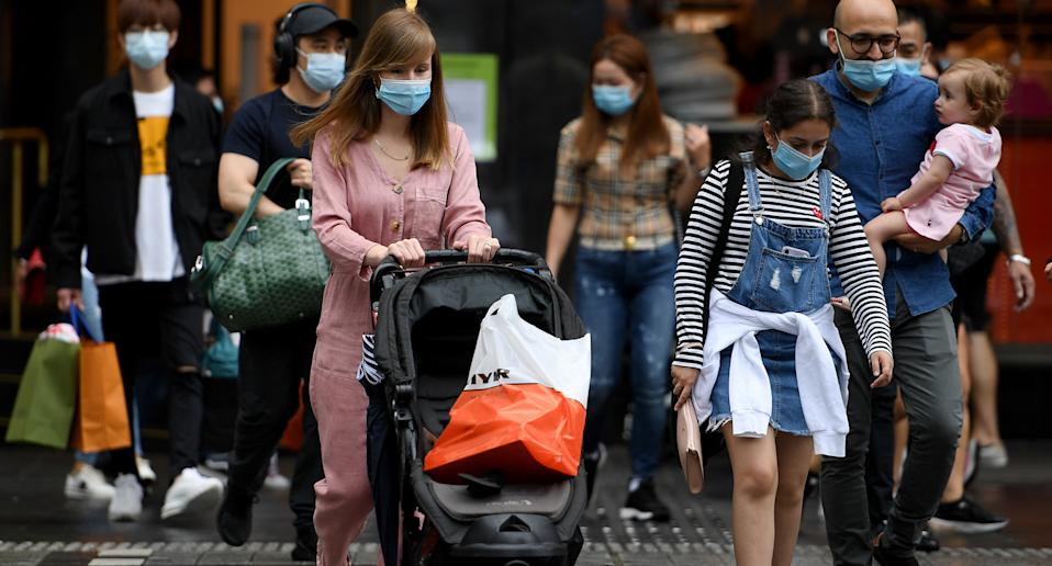 People are seen wearing masks in Sydney on January 2, 2021 where masks will soon be mandatory in Sydney shopping centres, on public transport and in entertainment venues.