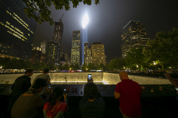 <p>A visitor takes a photo of the Tribute in Light on Sept. 11, 2018. (Photo: Gordon Donovan/Yahoo News) </p>