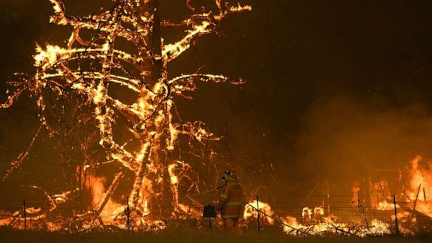 PHOTO: NSW Rural Fire Service crew fight the Gospers Mountain Fire as it impacts a property at Bilpin, New South Wales state, Australia, Dec. 21, 2019. (Dan Himbrechts/AAP Images via AP)