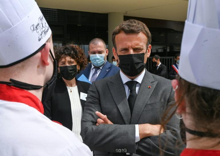 """French President Emmanuel Macron visiting the village of Tain-l'Hermitage as part of a nationwide tour to """"take the country's pulse"""""""