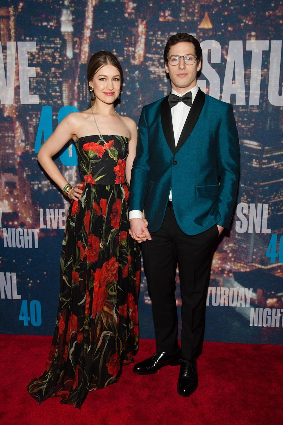 Andy Samberg, in a teal (the color of the night!) blazer, and his wife, Joanna Newsom, in a winter floral gown, take the top prize for best dressed couple on Sunday night. Even their color palates are perfectly coordinated!