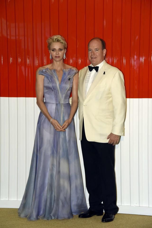 Prince Albert II of Monaco and his wife Princess Charlene arrive at the Red Cross Gala charity event in Monte Carlo, Monaco, July 23, 2016. REUTERS/Jean-Pierre Amet