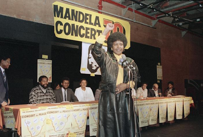 <p>Winnie Mandela, wife of jailed African National Congress leader Nelson Mandela, announces plans for an open-air pop concert near Soweto to celebrate her husband's 70th birthday on July 17, 1988. (Photo: John Parkin/AP) </p>