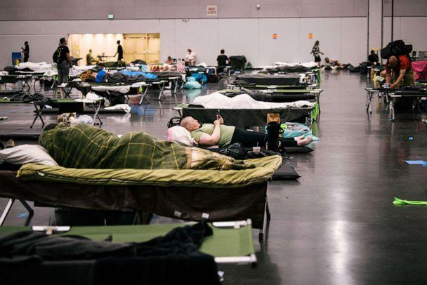 PHOTO: People rest at the Oregon Convention Center cooling station in Portland, OR, June 28, 2021, as a heatwave moves over much of the United States. (Kathryn Elsesser/AFP via Getty Images)