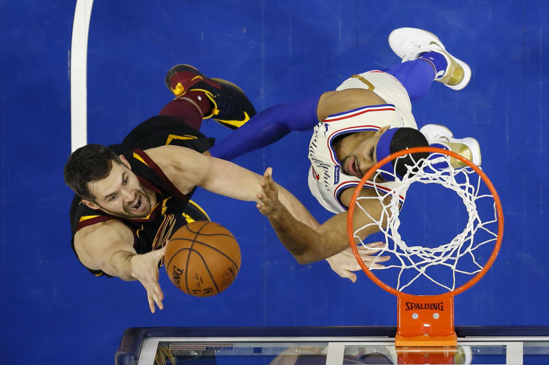 FILE - In this Dec. 7, 2019, file photo, Cleveland Cavaliers' Kevin Love, left, goes up to shoot against Philadelphia 76ers' Tobias Harris during the first half of an NBA basketball game, Saturday, Dec. 7, 2019, in Philadelphia. The NBA's decision to only invite 22 teams to resume play at Disney World in Florida next month was a body blow for players on the omitted squads _ aka the Delete 8. And although they have had time to process the exclusion, Sexton, Cavs star forward Love and their teammates, are still struggling with the reality that their season is over. (AP Photo/Matt Slocum, File)