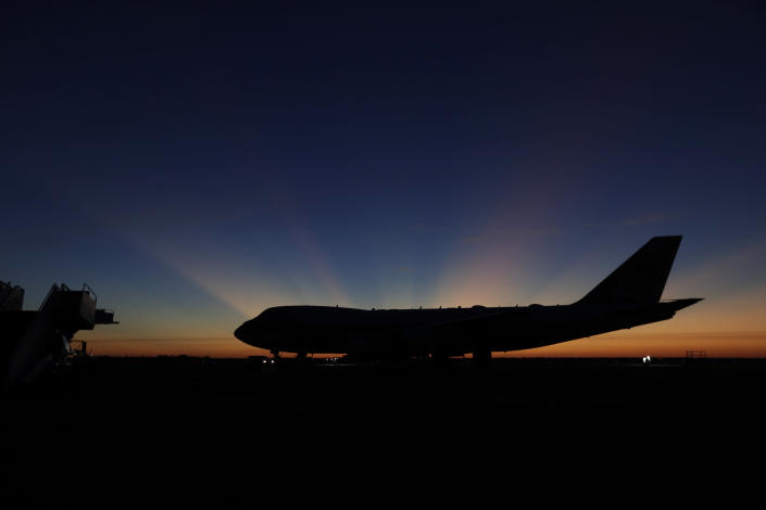 The sun rises behind Special Air Mission 41, the plane that will transfer the casket of former President George H.W. Bush to Washington,D.C., Monday, Dec. 3, 2018, in Houston. (Photo: Eric Gay/AP)