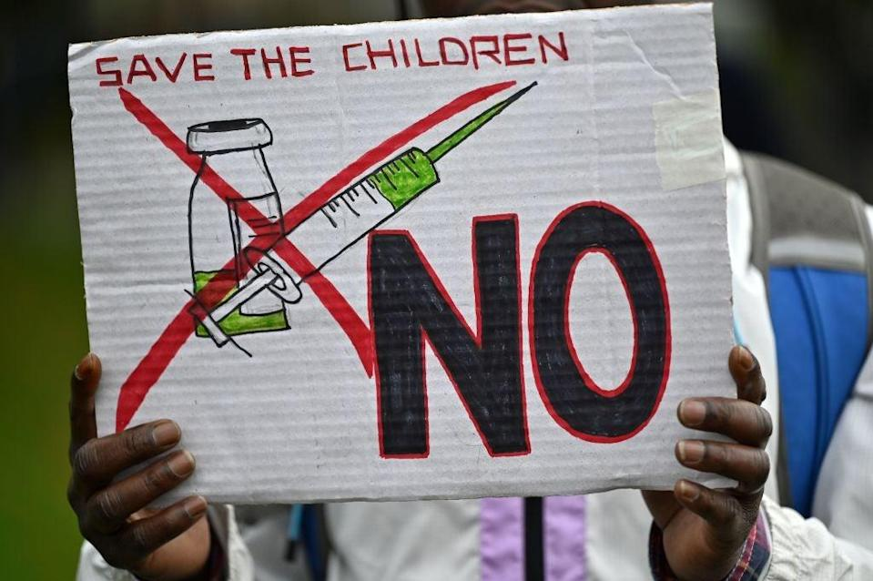 <p>A protester's placard at a demonstration against vaccinations in London in October</p> (AFP via Getty Images)