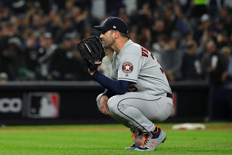 BRONX, NY - OCTOBER 18: Justin Verlander #35 of the Houston Astros reacts after giving up a three-run home run to Aaron Hicks #31 of the New York Yankees during the first inning of Game 5 of the ALCS between the Houston Astros and the New York Yankees at Yankee Stadium on Friday, October 18, 2019 in the Bronx borough of New York City. (Photo by Alex Trautwig/MLB Photos via Getty Images)