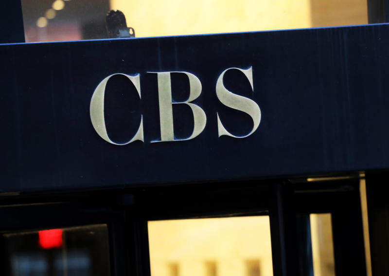 """FILE - This Dec. 6, 2018, file photo shows the CBS logo at the entrance to its headquarters, in New York. The CBS game """"Survivor"""" ends its 39th edition this week reeling from controversy over its first-ever forced removal of a contestant, a Hollywood agent sent packing after young women complained about inappropriate touching. (AP Photo/Mark Lennihan, File)"""