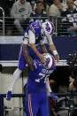 Buffalo Bills' Josh Allen (17) is lifted up by guard Jon Feliciano (76) after Allen ran the ball for a touchdown in the second half of an NFL football game against the Dallas Cowboys in Arlington, Texas, Thursday, Nov. 28, 2019. (AP Photo/Michael Ainsworth)