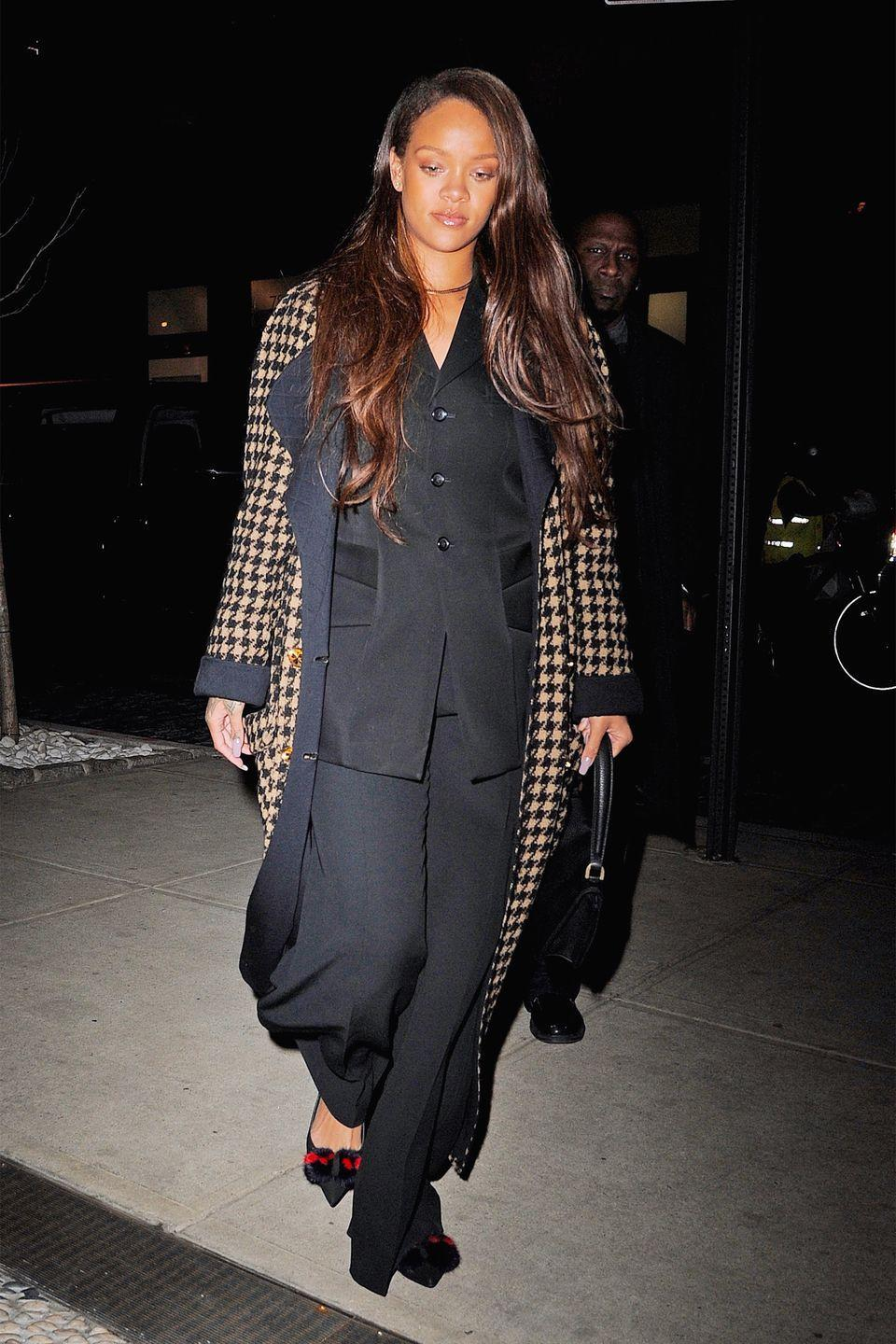 <p>In a houndstooth coat, oversized blazer, wide-leg trousers and pointed-toe flats while out in New York City. </p>