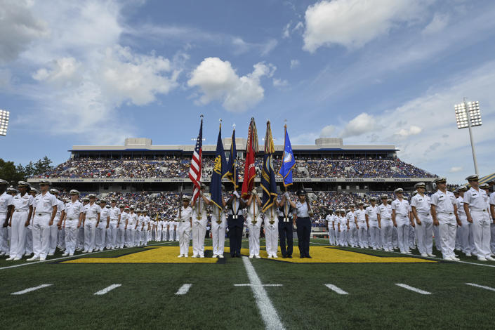The Brigade of Midshipmen stand at attention before the playing of the National Anthem before NCAA college football game between Navy and Air Force, Saturday, Sept. 11, 2021, in Annapolis, Md. (AP Photo/Terrance Williams)