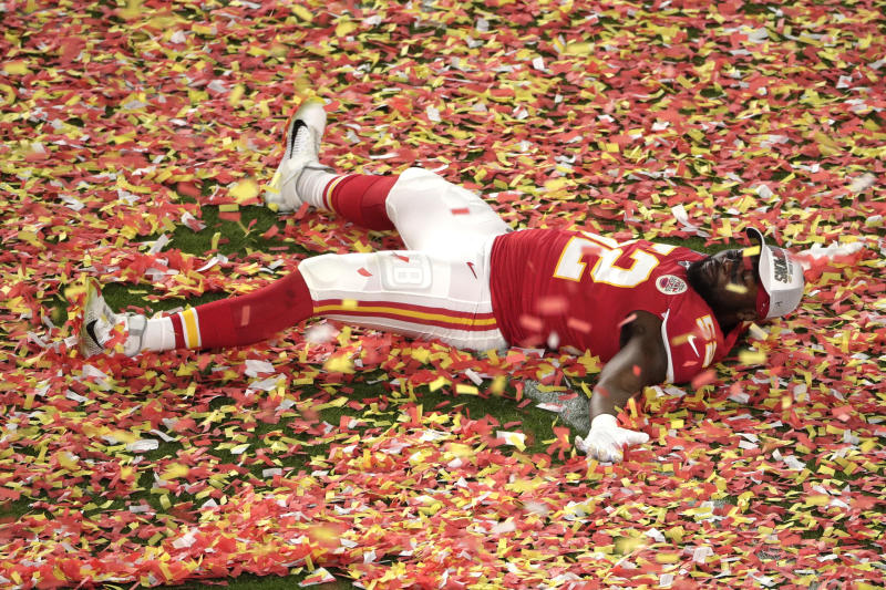 Kansas City Chiefs' Demone Harris (52) plays with the confetti, at the end of the NFL Super Bowl 54 football game against the San Francisco 49ers, Sunday, Feb. 2, 2020, in Miami Gardens, Fla. The Chiefs' defeated the 49ers 31-20. (AP Photo/Charlie Riedel)