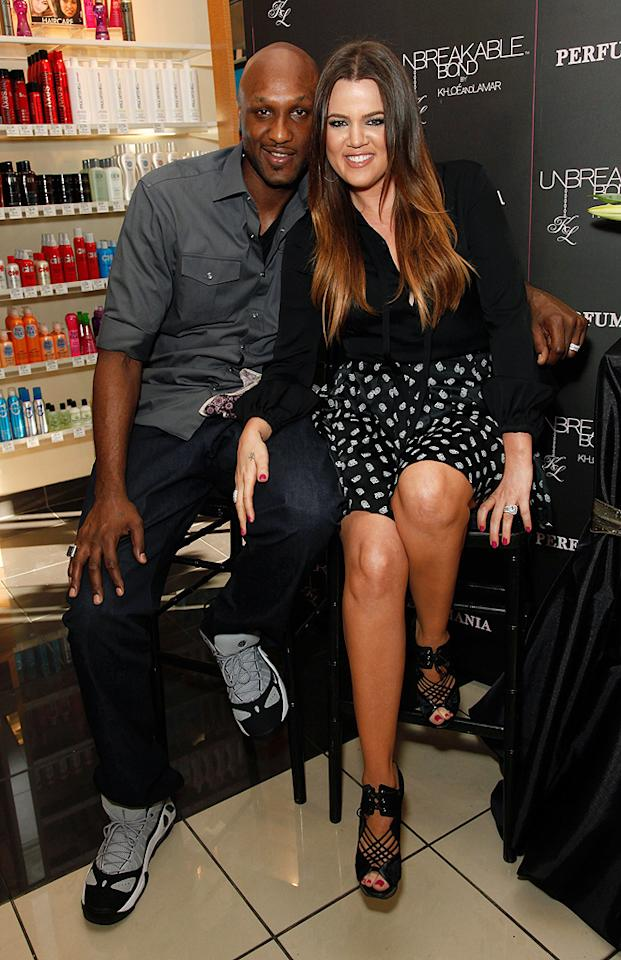 ORANGE, CA - JUNE 07:  Professional basketball player Lamar Odom and TV personality Khloe Kardashian make an appearance to promote their fragrance, 'Unbreakable Bond,' at Perfumania on June 7, 2012 in Orange, California.  (Photo by Imeh Akpanudosen/Getty Images)