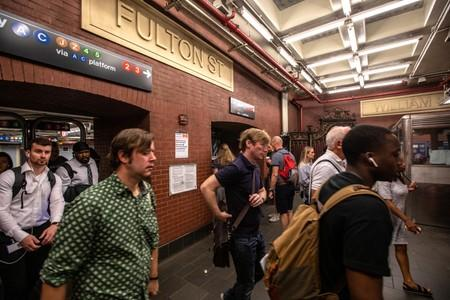 Commuters are seen inside the Fulton Street subway station after police investigated two suspicious packages in Manhattan