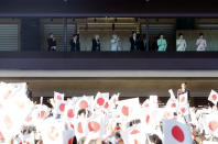 Japan's Emperor Akihito, third left, appears to greet well-wishers from the bullet-proofed balcony during his New Year's public appearance with his family members at Imperial Palace in Tokyo Wednesday, Jan. 2, 2019. (AP Photo/Eugene Hoshiko)