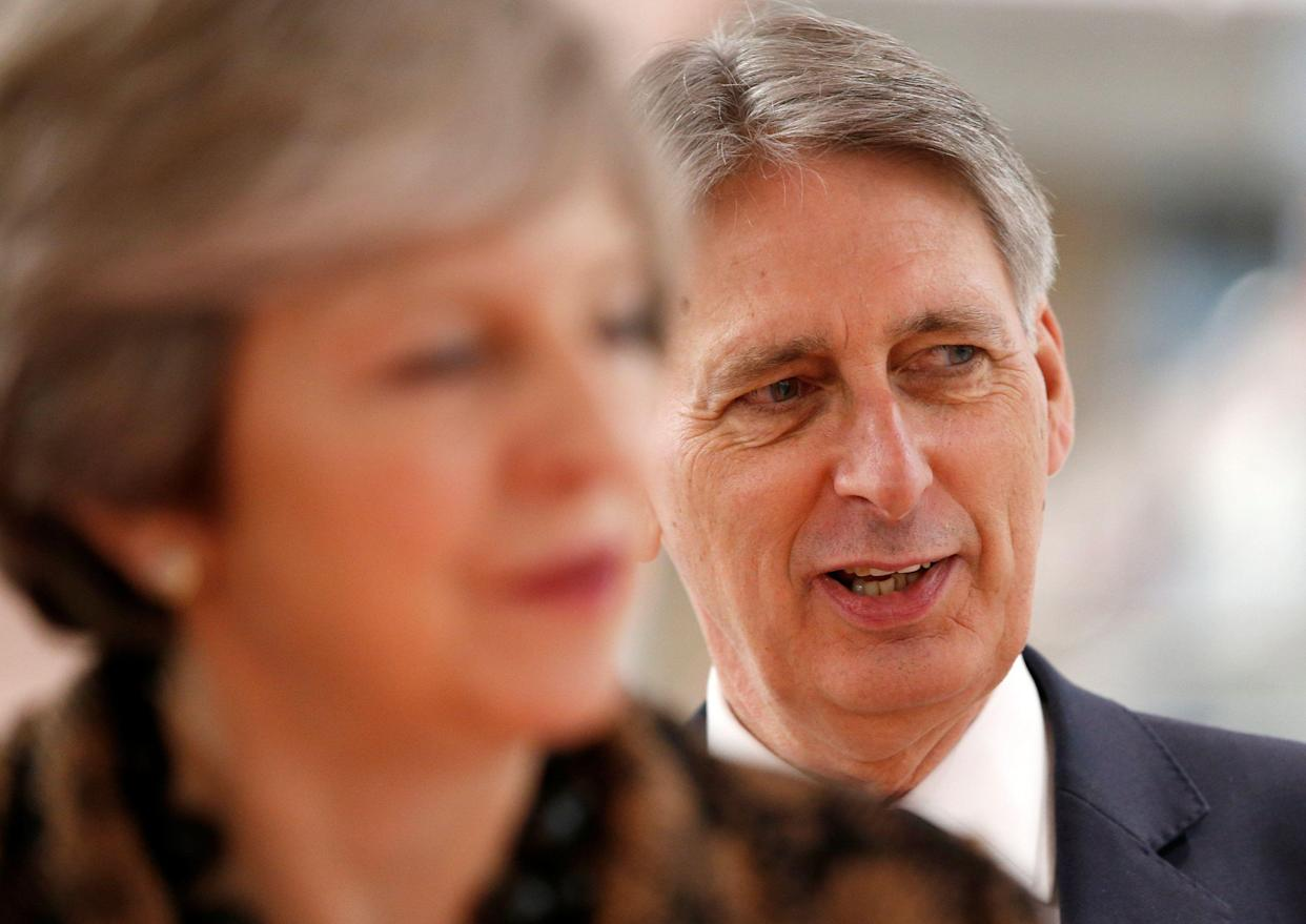 BIRMINGHAM, ENGLAND - NOVEMBER 20: Prime Minister Theresa May and Chancellor of the Exchequer Philip Hammond visit an engineering training facility on November 20, 2017 in Birmingham, Untied Kingdom. (Photo by Andrew Yates - WPA Pool/Getty Images)