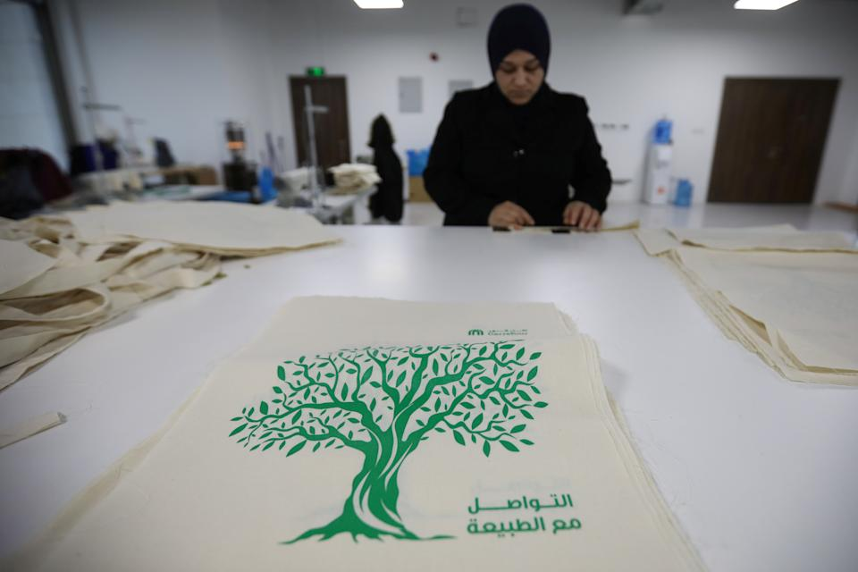A woman works in the creation of tote bags as part of the Teeah project, which aims to promote the reduction of plastic bags use, in Irbid, Jordan January 22, 2020. Picture taken January 22, 2020. REUTERS/Muhammad Hamed