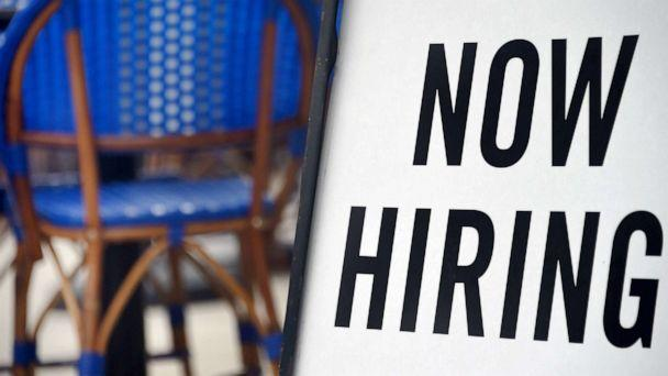 PHOTO: A 'Now Hiring' sign is displayed at a restaurant in Arlington, Va. amid the coronavirus pandemic, Aug. 4, 2020  (Olivier Douliery/AFP via Getty Images, FILE)