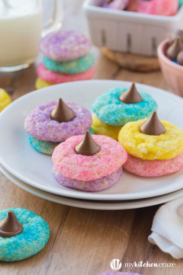 """<p>These chewy, sugar-coated cookies are topped with a sweet chocolate kiss, making them the perfect springtime treat. </p><p><em><a href=""""https://mykitchencraze.com/easter-blossom-sugar-cookies/"""" rel=""""nofollow noopener"""" target=""""_blank"""" data-ylk=""""slk:Get the recipe from My Kitchen Craze »"""" class=""""link rapid-noclick-resp"""">Get the recipe from My Kitchen Craze »</a></em></p><p><strong>RELATED: </strong><a href=""""https://www.goodhousekeeping.com/food-recipes/dessert/g30468803/easy-spring-desserts/"""" rel=""""nofollow noopener"""" target=""""_blank"""" data-ylk=""""slk:30 Spring Desserts Perfect for Spring Entertaining"""" class=""""link rapid-noclick-resp"""">30 Spring Desserts Perfect for Spring Entertaining</a></p>"""