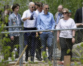 Former vice president and Democratic presidential candidate Joe Biden, second from left, views a park in Boston on Wednesday, June 5, 2019, with Bill and Denise Richard, right, and their son Henry, left, being constructed in honor of Martin Richard, the youngest victim of the 2013 Boston Marathon bombings. (AP Photo/Steven Senne)