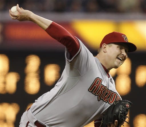 Arizona Diamondbacks starting pitcher Trevor Cahill works the first inning against the San Diego Padres in a baseball game Tuesday, April 10, 2012 in San Diego. (AP Photo/Lenny Ignelzi)