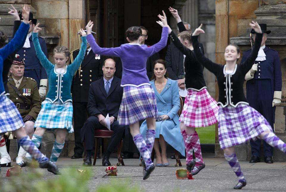 The Duke and Duchess of Cambridge watch Highland dancers perform at the Beating of the Retreat at the Palace of Holyroodhouse in Edinburgh. Picture date: Thursday May 27, 2021.