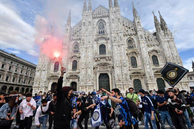 Inter Milan fans celebrate their team's Serie A title in the Piazza Duomo